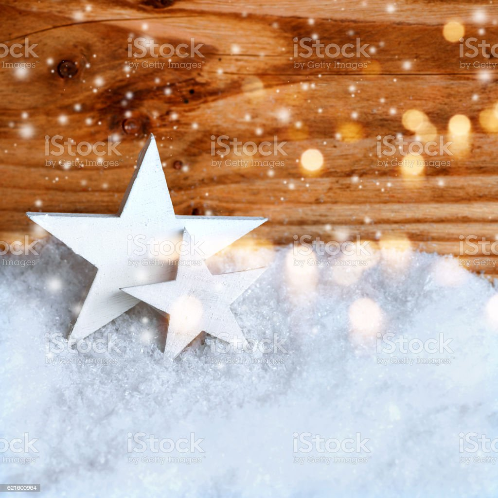Christmas stars in the snow stock photo