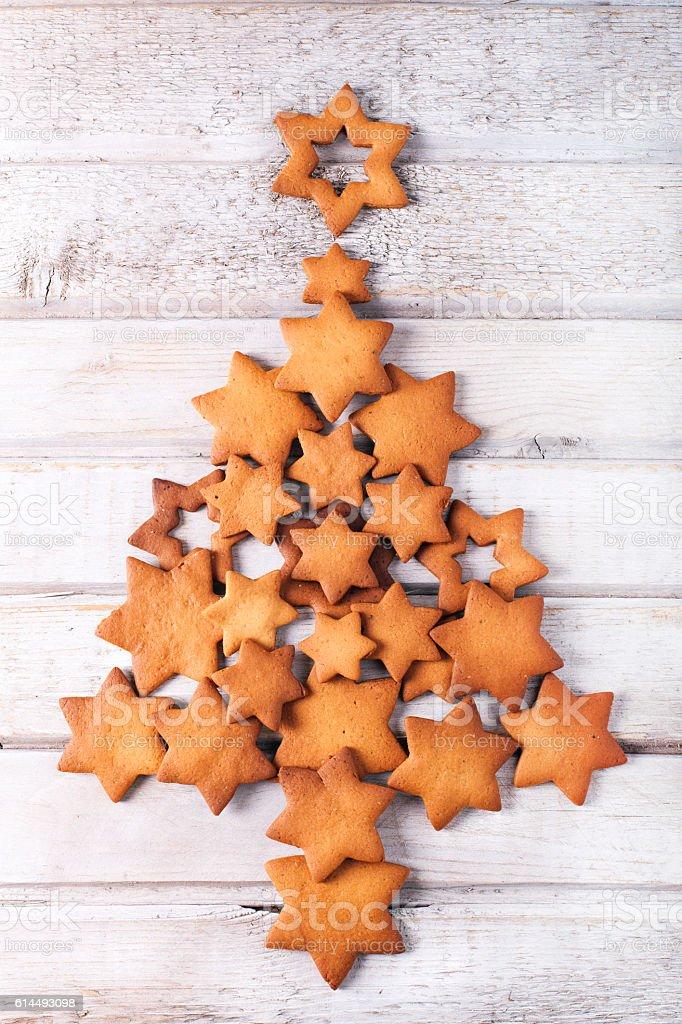 Christmas star-shaped cookies arranged to look like a tree stock photo