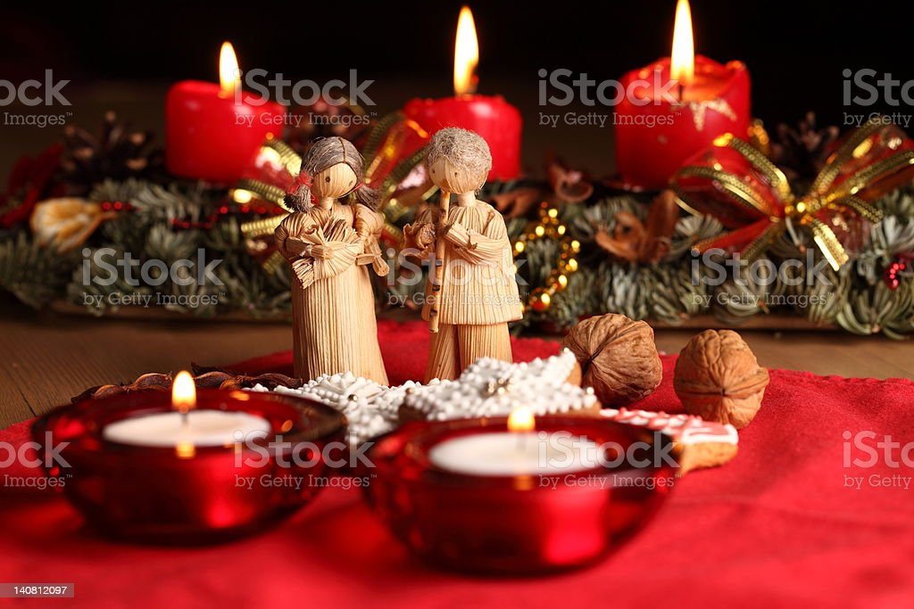 Christmas still-life in a red colour with hand made figures royalty-free stock photo