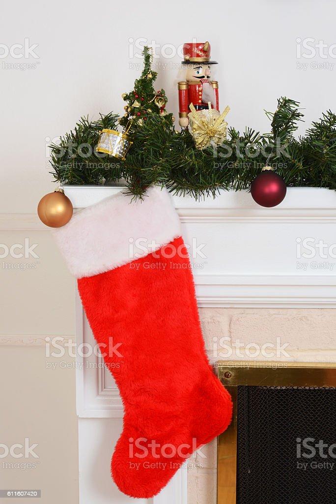 christmas stocking on fireplace stock photo