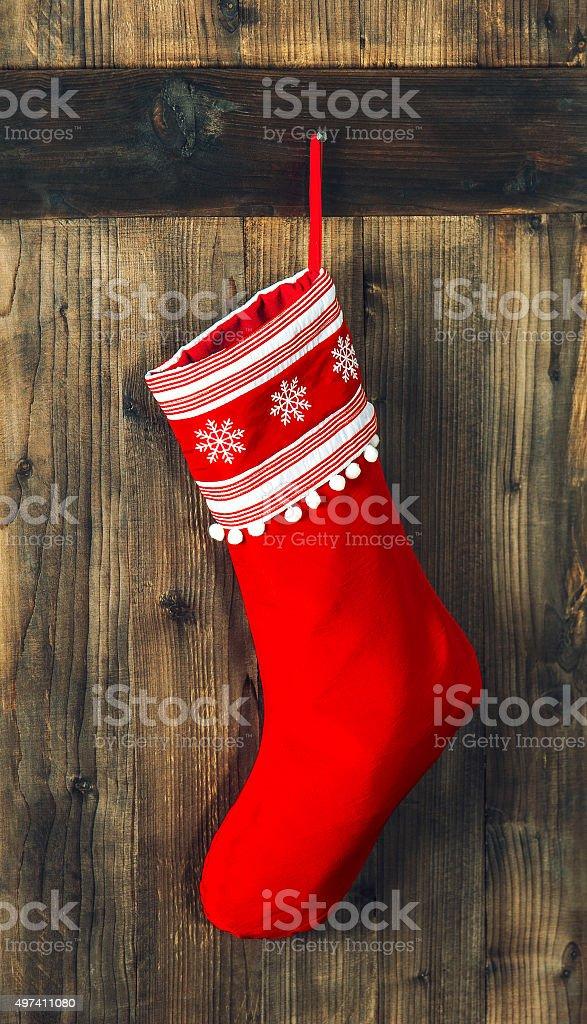 Christmas stocking. Red sock hanging. Holidays decoration stock photo