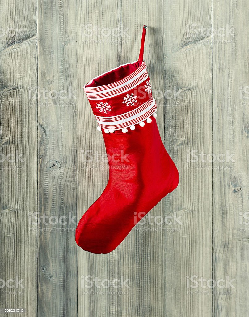 christmas stocking. red sock with snowflakes for gifts stock photo