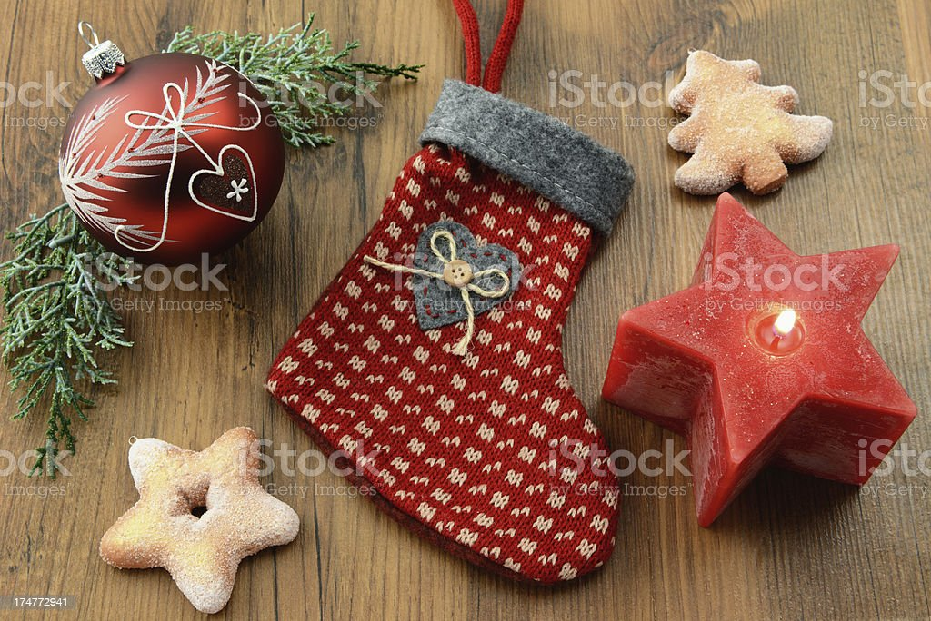 Christmas Stocking with cookies and candle stock photo