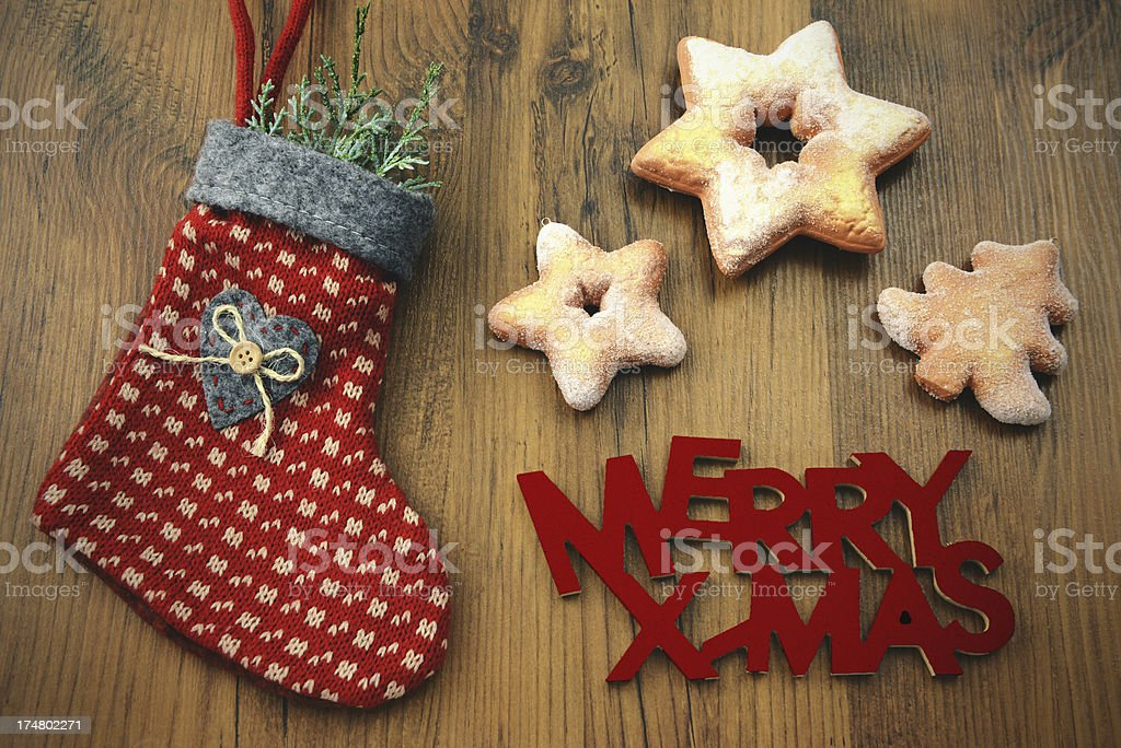 Christmas Stocking with cookies and Merry Xmas words stock photo