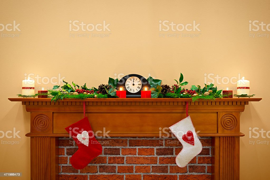 Christmas stockings and garland on a mantlepiece stock photo