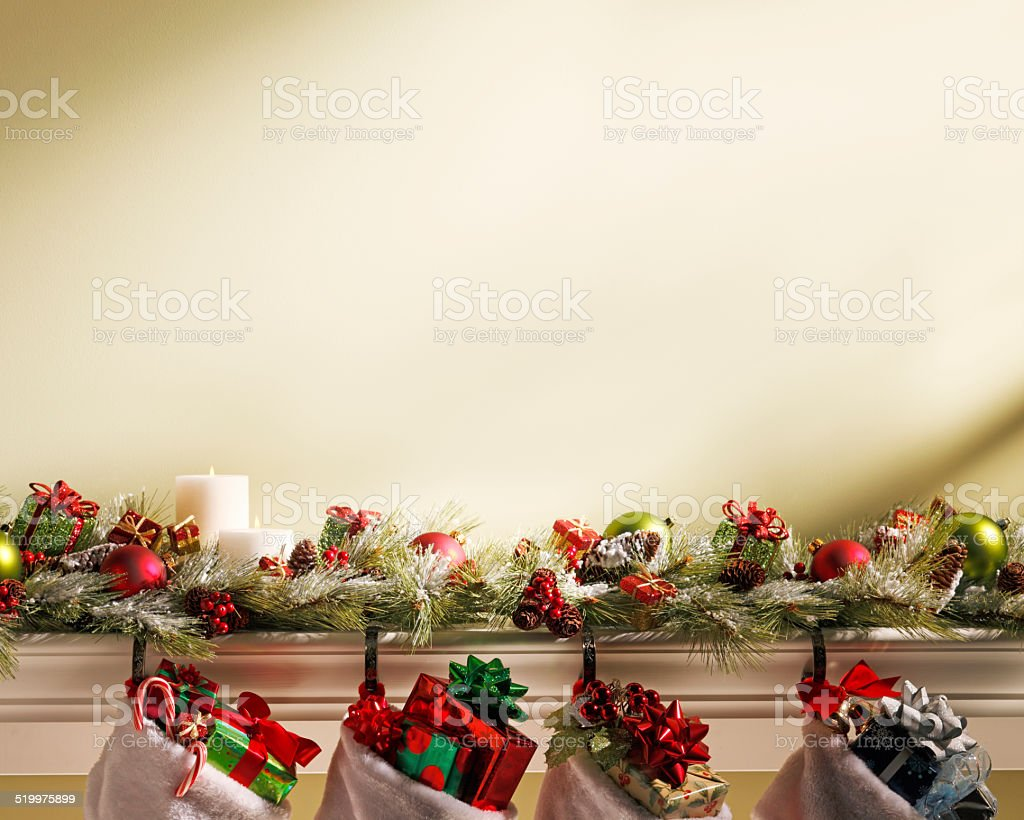 Christmas Stockings Hanging On Mantlepiece stock photo