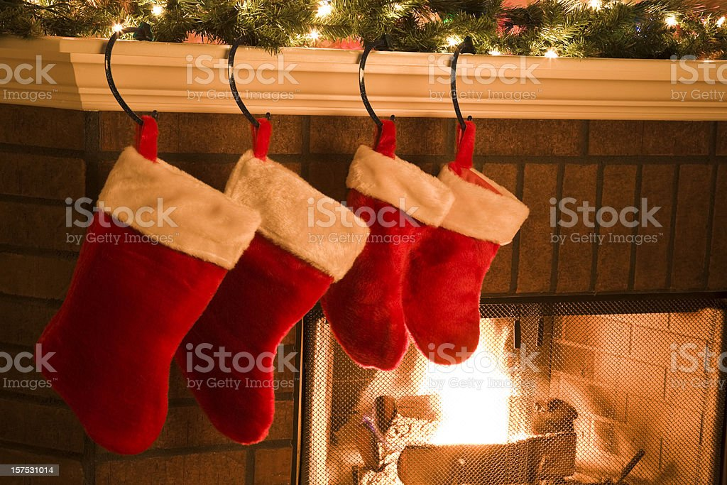 Christmas Stockings hung on Mantel by Holiday Season Fireplace royalty-free stock photo