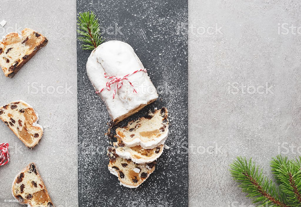 Christmas stollen dusted with icing sugar stock photo
