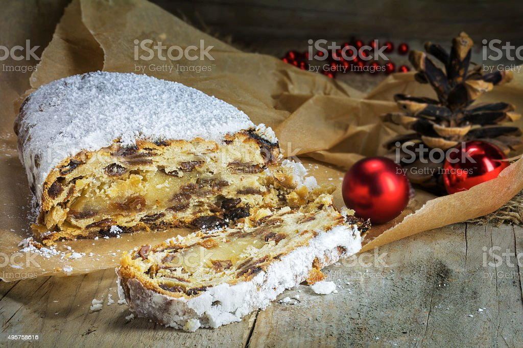 Christmas stollen, traditional German cake in brown paper on rus stock photo
