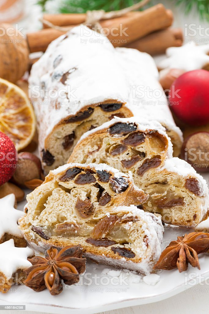 Christmas Stollen with dried fruit, cookies and spices, vertical stock photo
