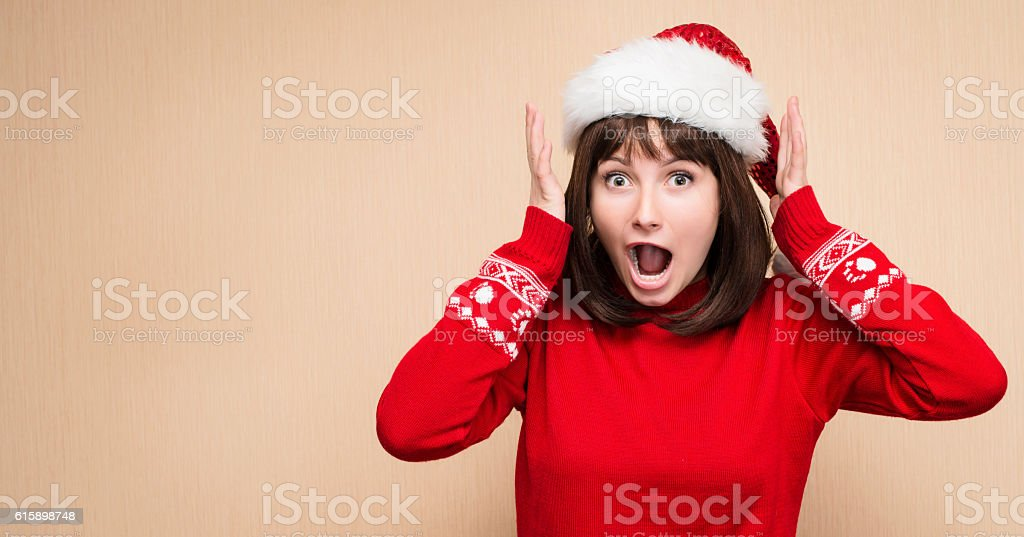 Christmas stress. Woman wearing santa hat stressing for christmas shopping stock photo