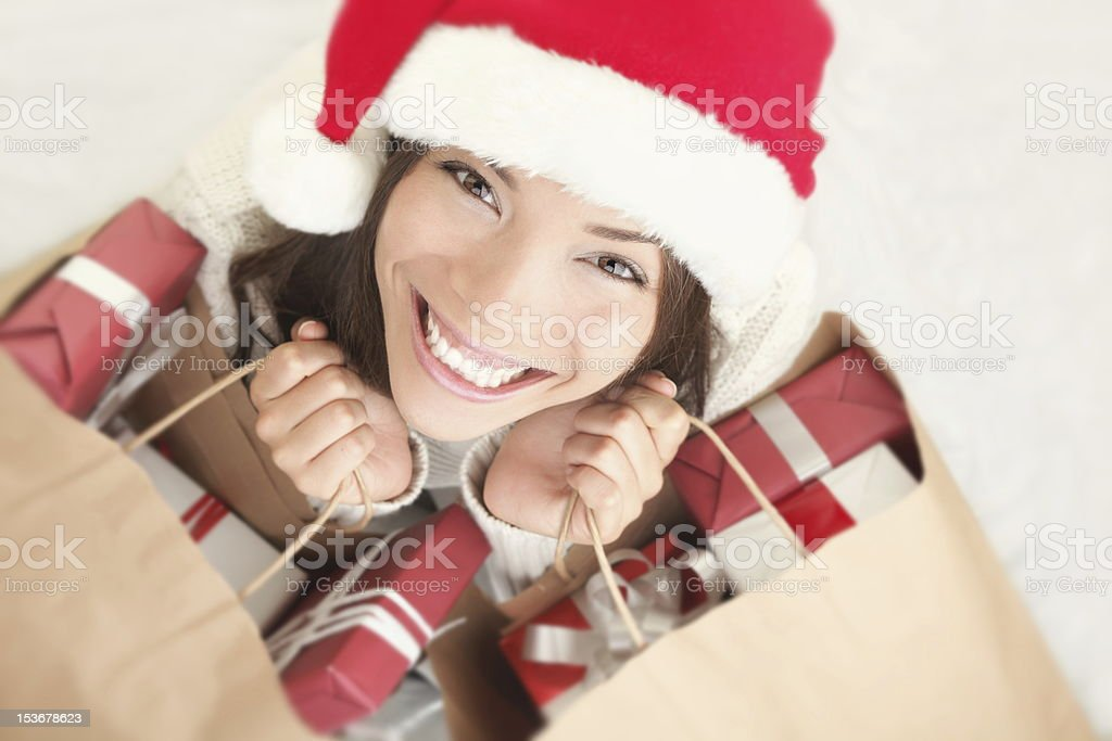A Christmas style dressed woman smiling and looking up royalty-free stock photo