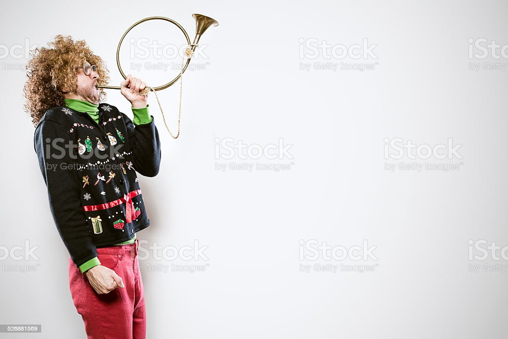 Christmas Sweater Man with Trumpet stock photo