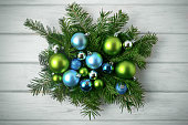 Christmas table centerpiece with blue and green ornaments, toned