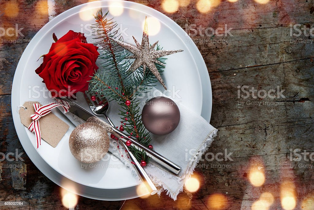 Christmas table place setting on old wooden Table stock photo