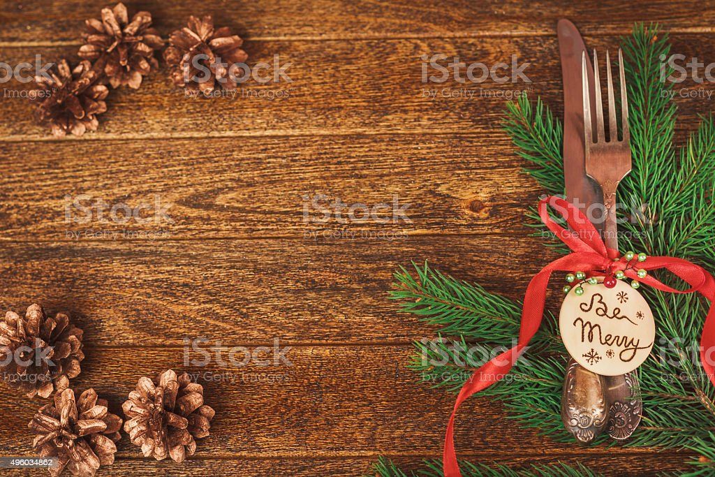 Christmas table place setting with christmas pine branches, ribb stock photo