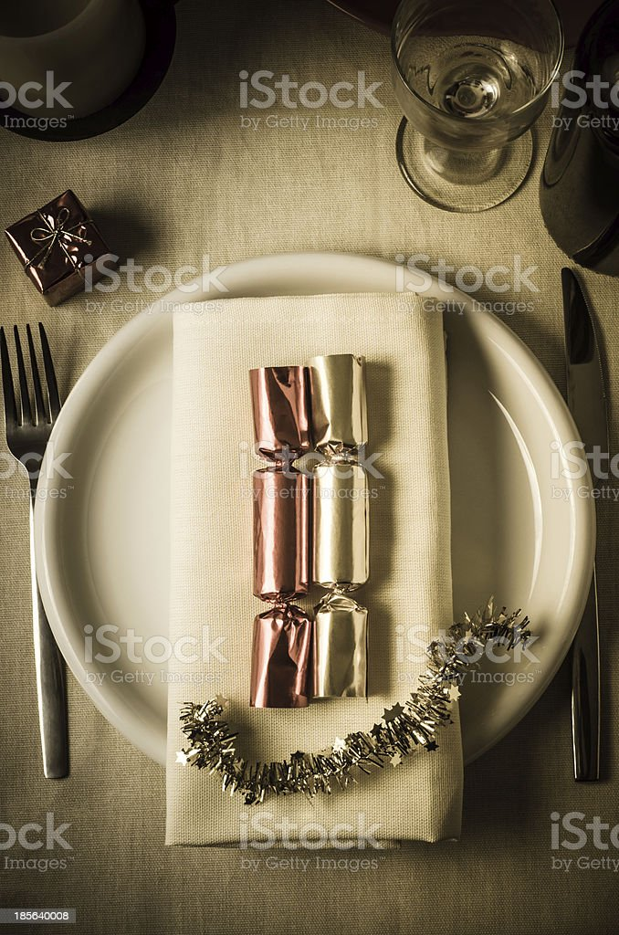 Christmas Table Setting with Crackers royalty-free stock photo