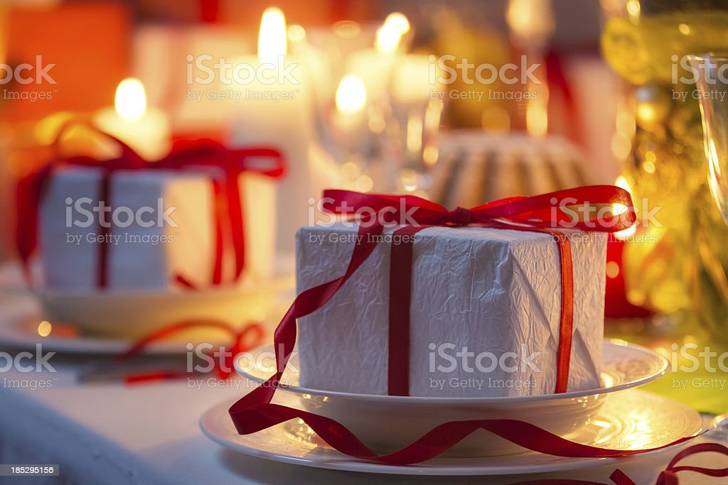 Christmas table setting with gifts royalty-free stock photo