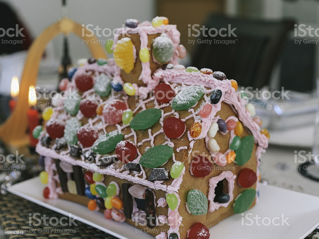 Christmas table setting with gingerbread house stock photo