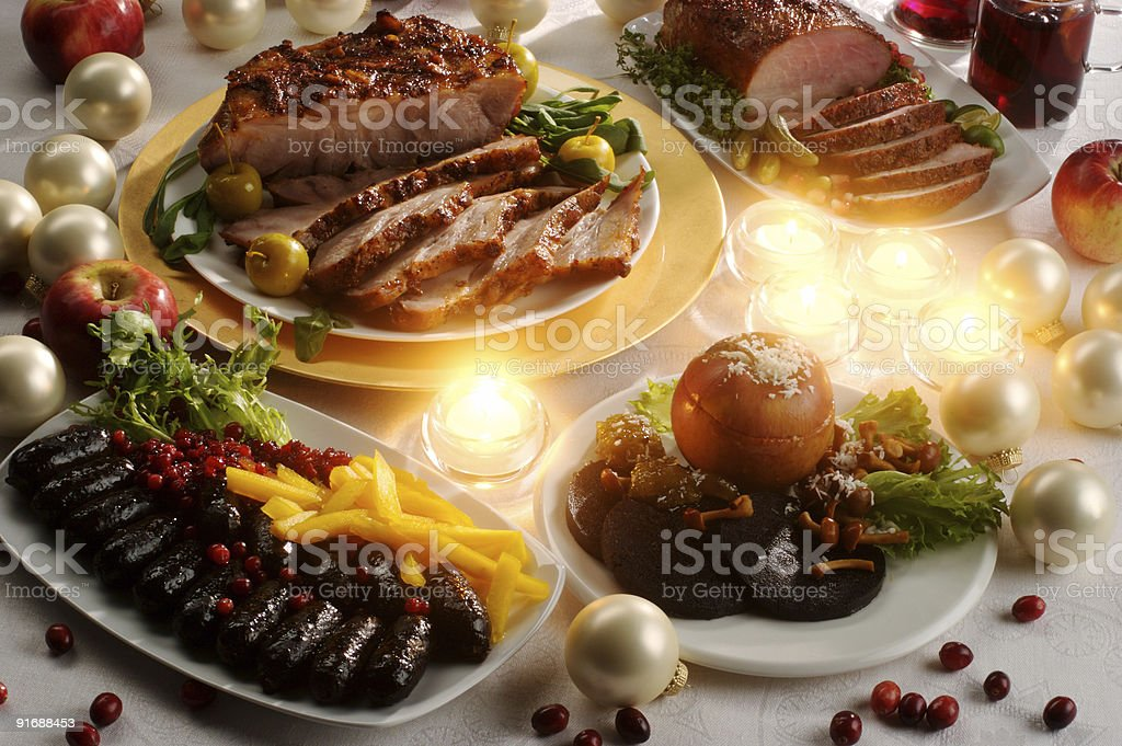 Christmas table with roasted pork royalty-free stock photo