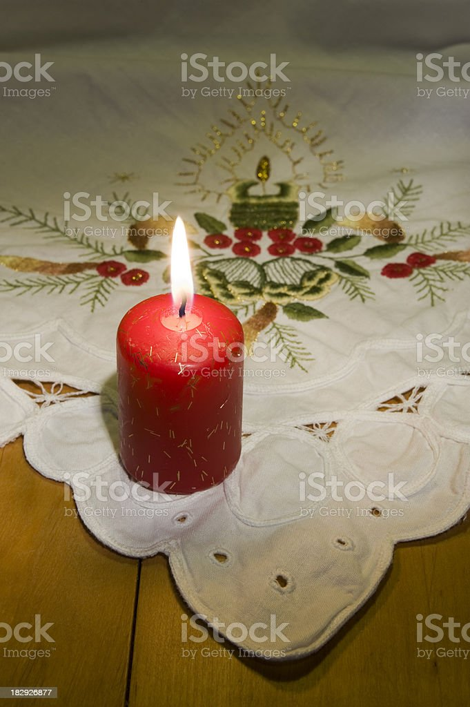 Christmas tablecloth with red candle stock photo