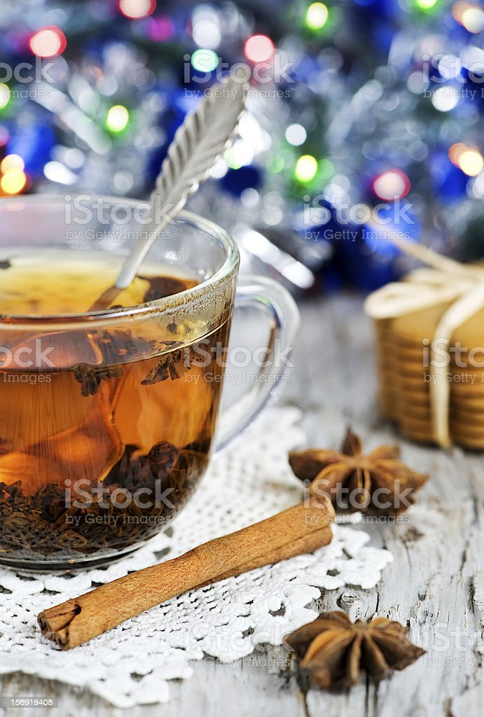 Christmas tea and shiny garland royalty-free stock photo