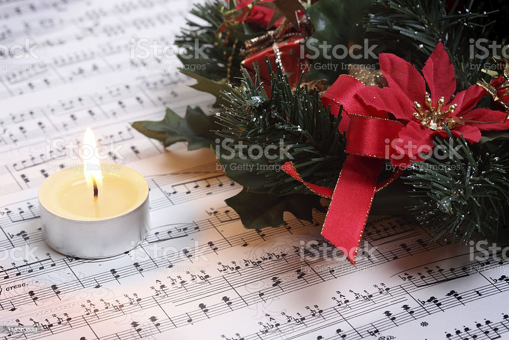 Christmas Tea Light with Music Notes and  Decoration Wreath royalty-free stock photo