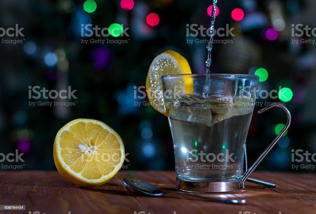 Christmas tea with lemon on a wooden table stock photo