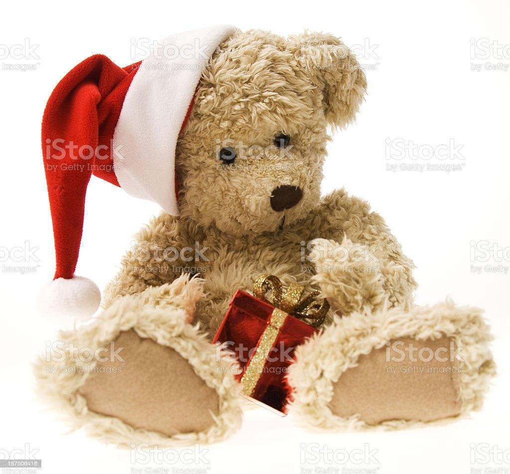 Christmas Teddy Bear Opening Gift royalty-free stock photo