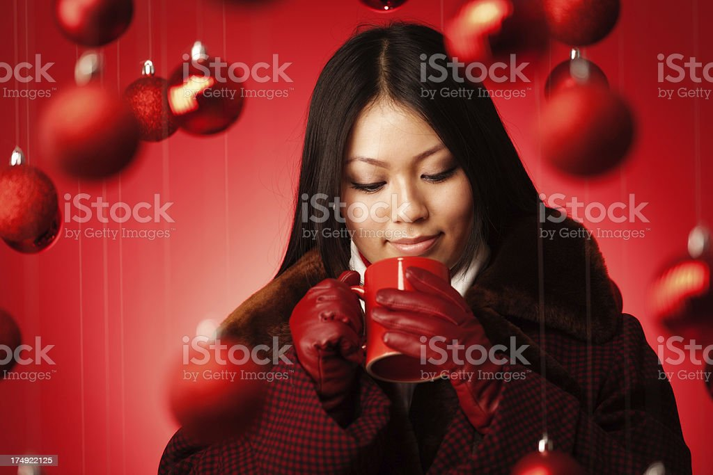 Christmas Theme Asian Model in Winter Fashion and Hot Drink royalty-free stock photo