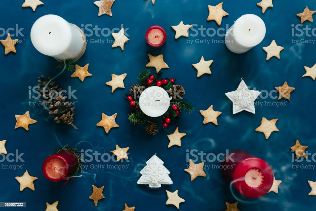 Christmas themed background top view with candles, cookies, toys stock photo