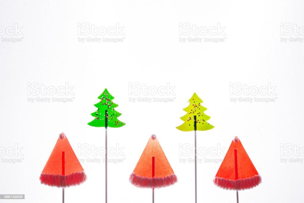Christmas themed lollipops on white stock photo
