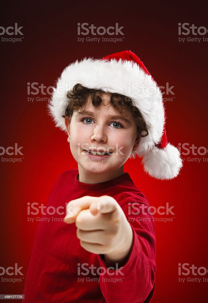Christmas time - boy with Santa Clause hat stock photo