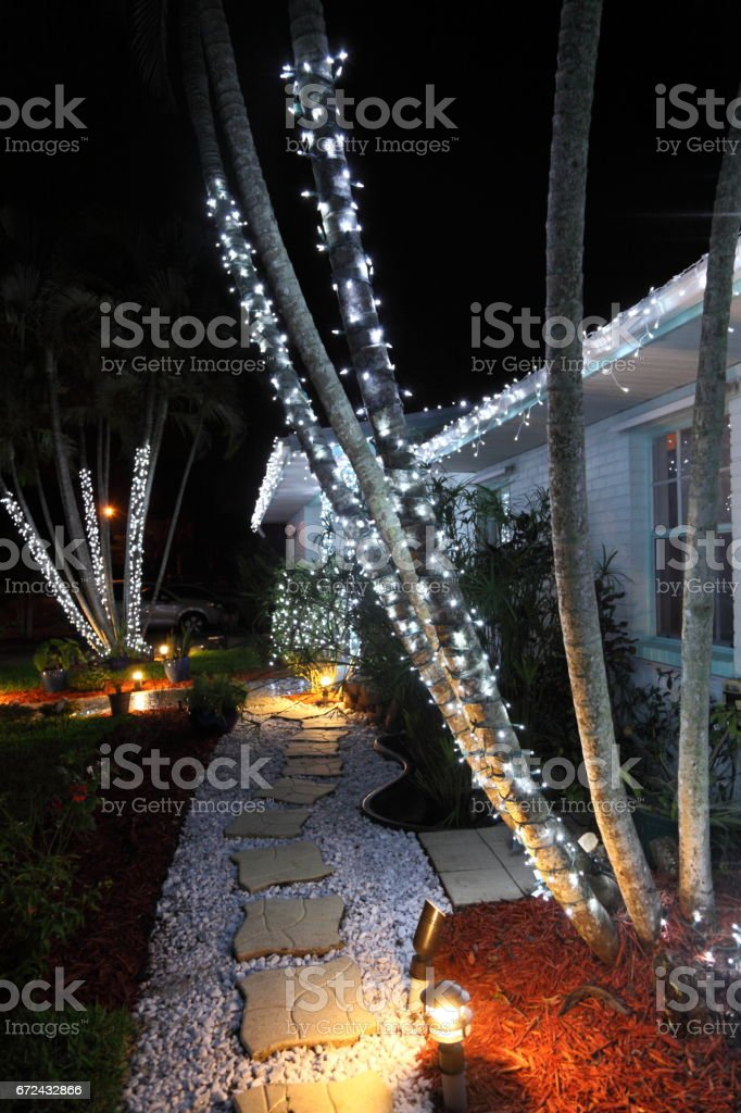 Christmas time exterior lighting. stock photo