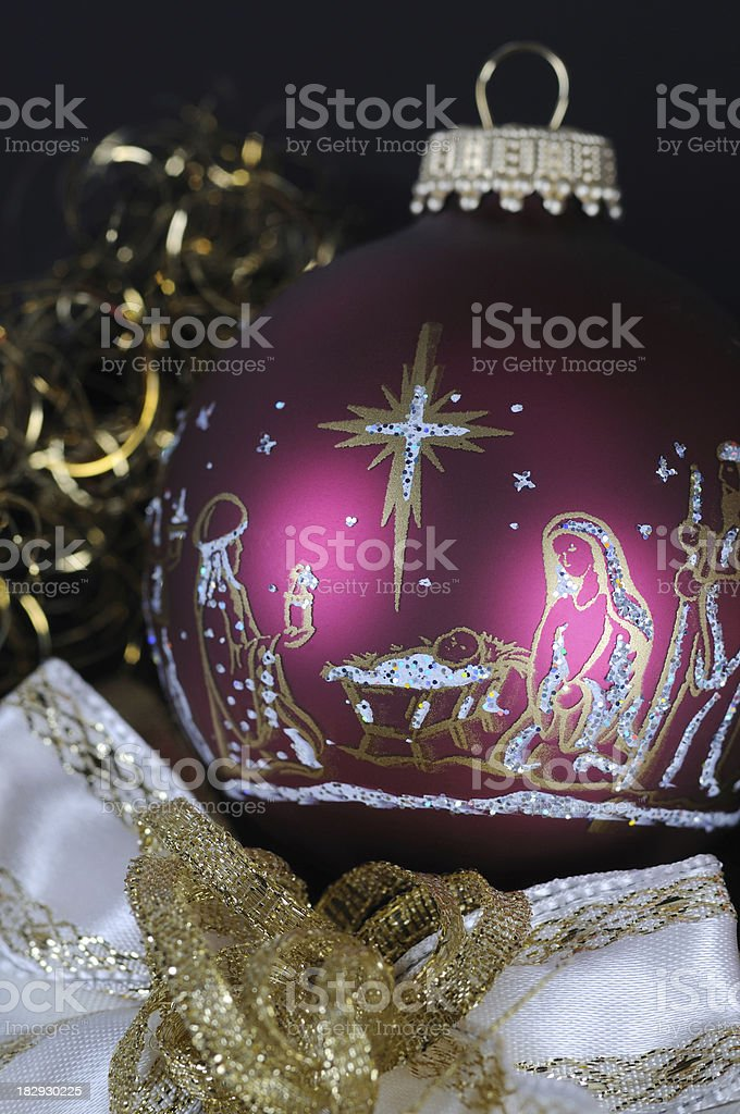 Christmas Time Painted Red Bauble with Jesus Birth stock photo