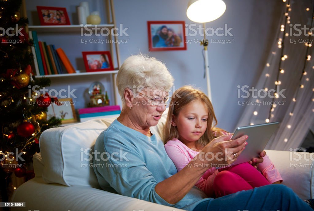 Christmas time with grandmother and technology stock photo