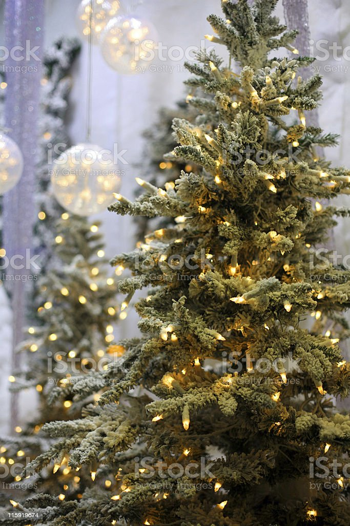 A Christmas tree adorned with white lights stock photo