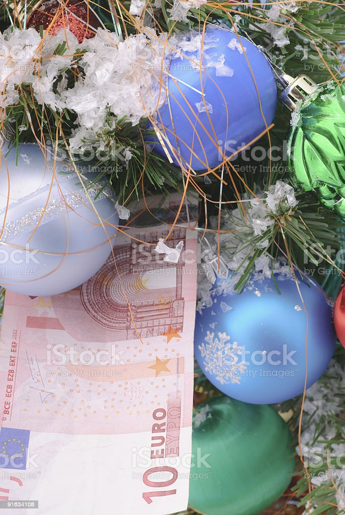 Christmas tree and banknote euro royalty-free stock photo