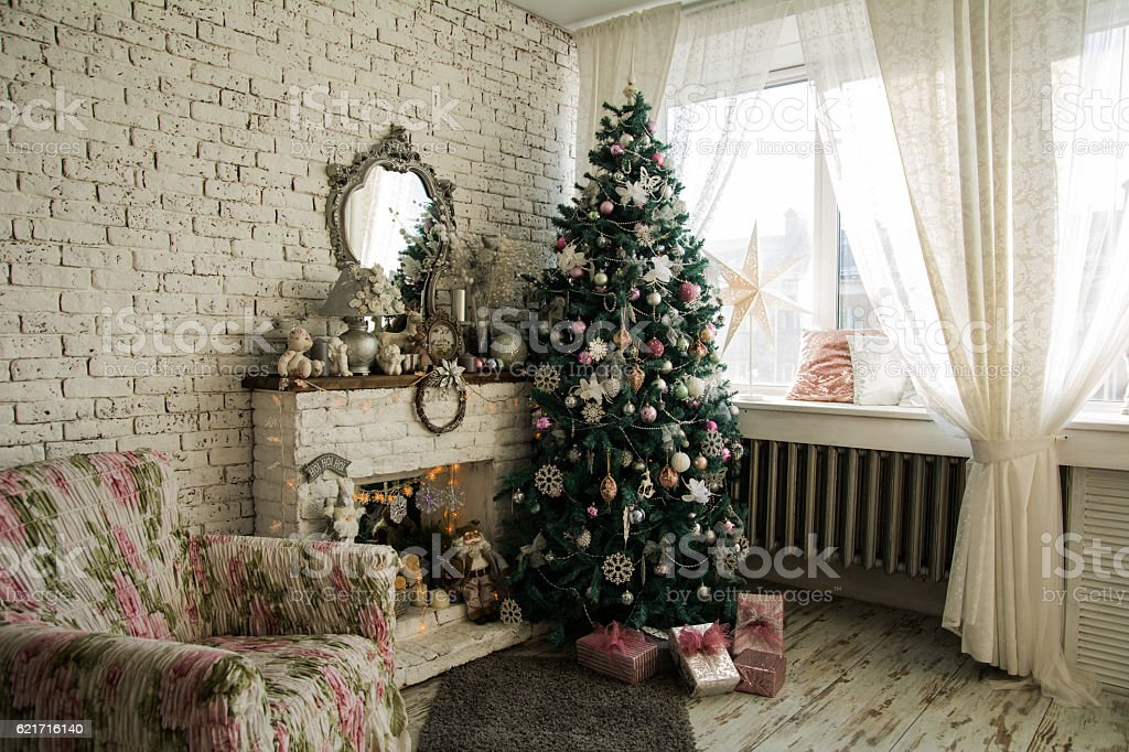 Christmas tree and fireplace with an armchair stock photo
