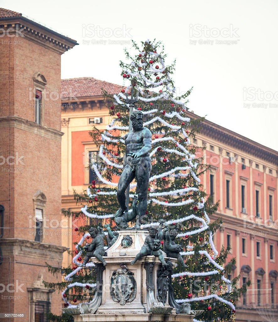 Christmas tree and Fountain of Neptune, Bologna Italyin Bologna, Italy stock photo