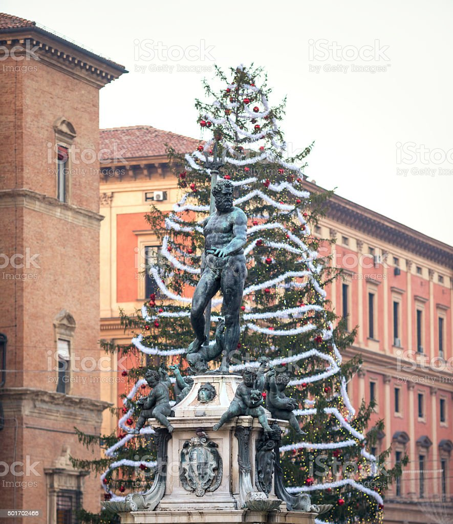 Christmas tree and Fountain of Neptune, Bologna Italyin Bologna, Italy stock photo