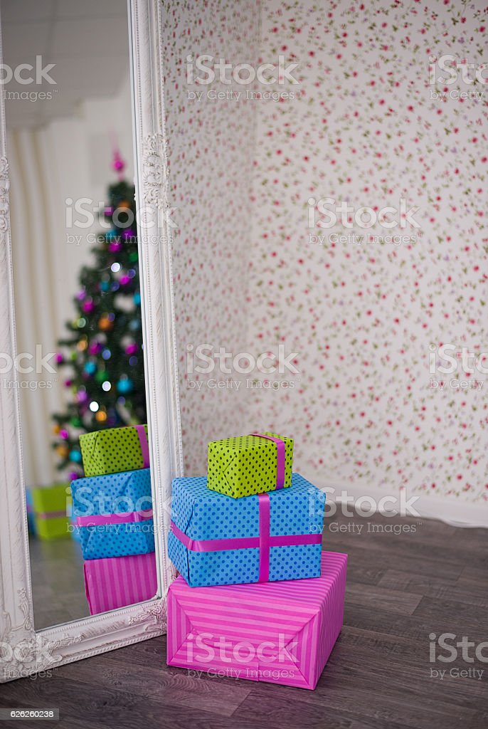 Christmas tree and gifts reflected in the mirror stock photo