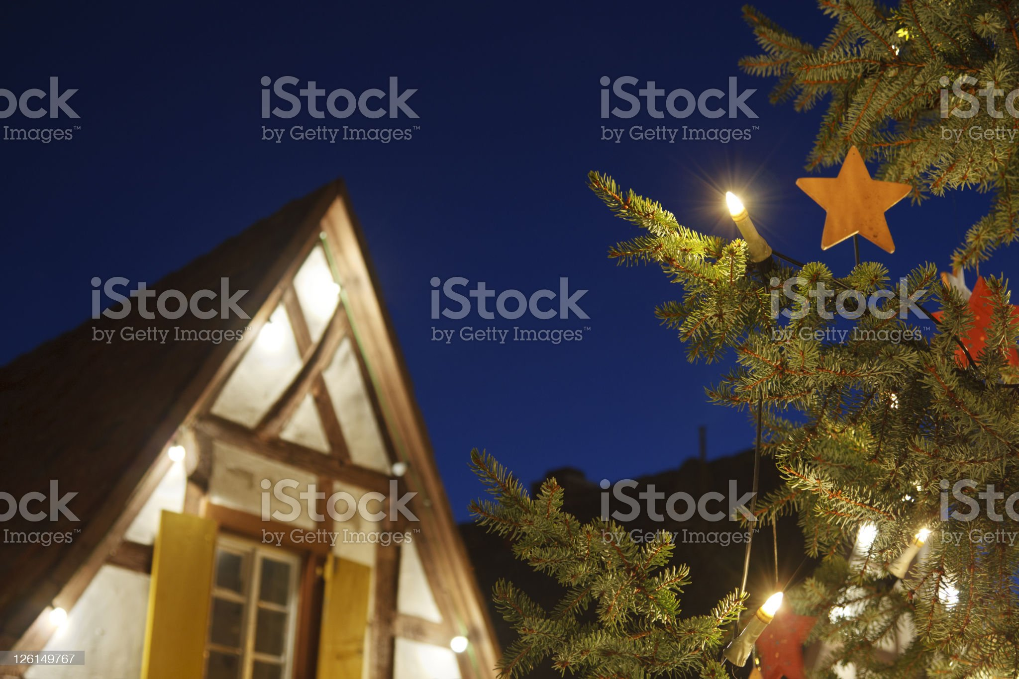 Christmas Tree And House At Night royalty-free stock photo
