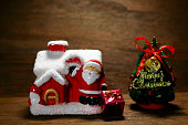 Christmas tree and Santa Claus and house