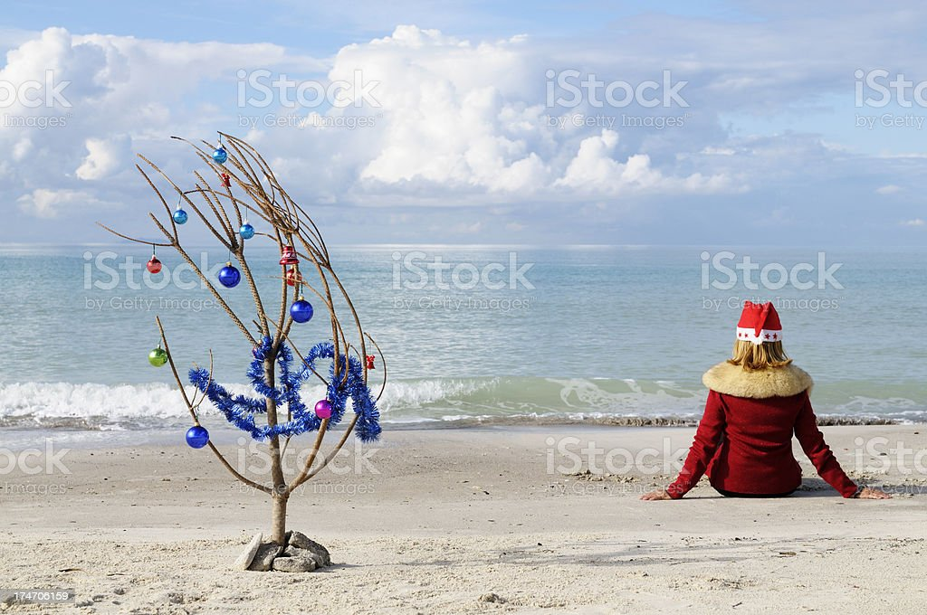 Christmas Tree and Santa Claus on the Sand royalty-free stock photo