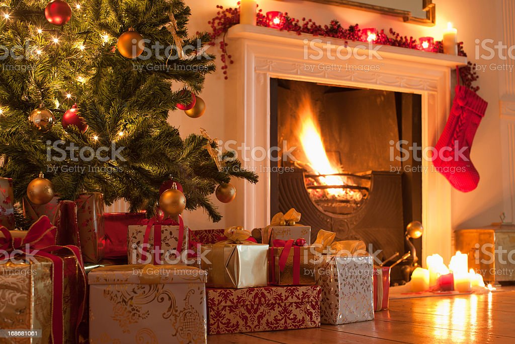 Christmas tree and stocking near fireplace stock photo
