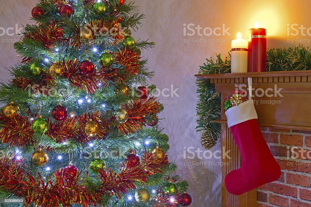 Christmas tree and stocking over the fireplace royalty-free stock photo