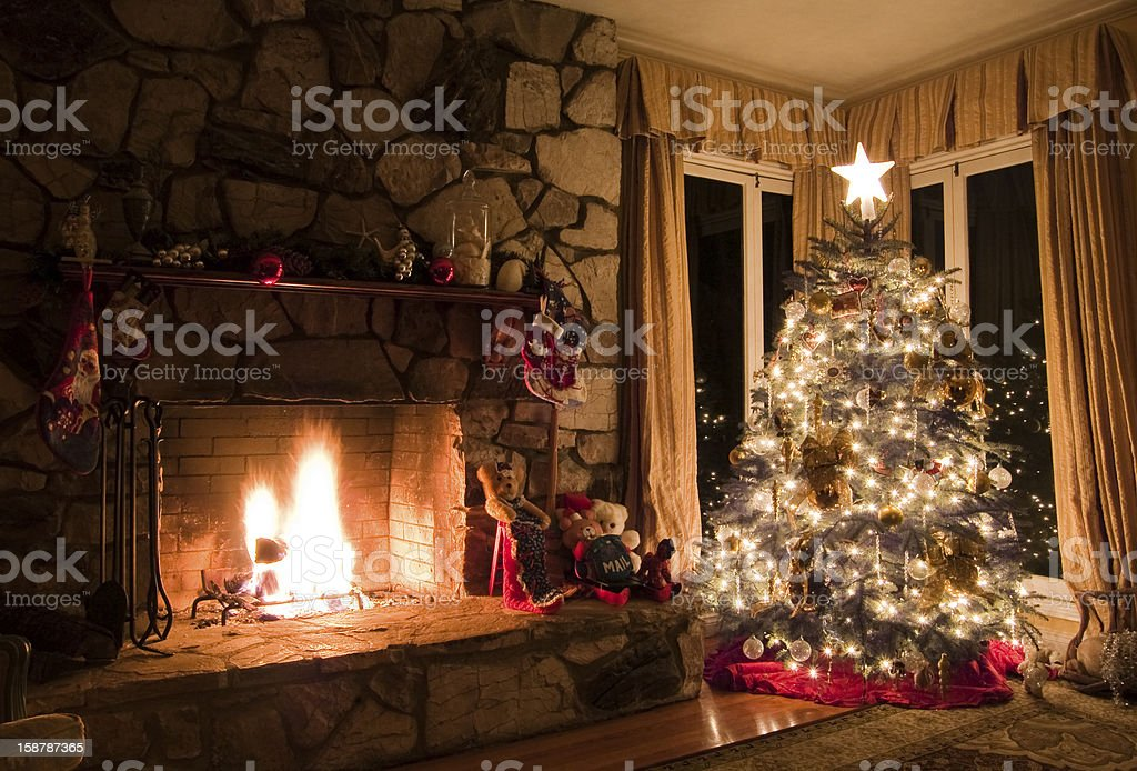 Christmas tree and stone fireplace in a cozy vintage home stock photo