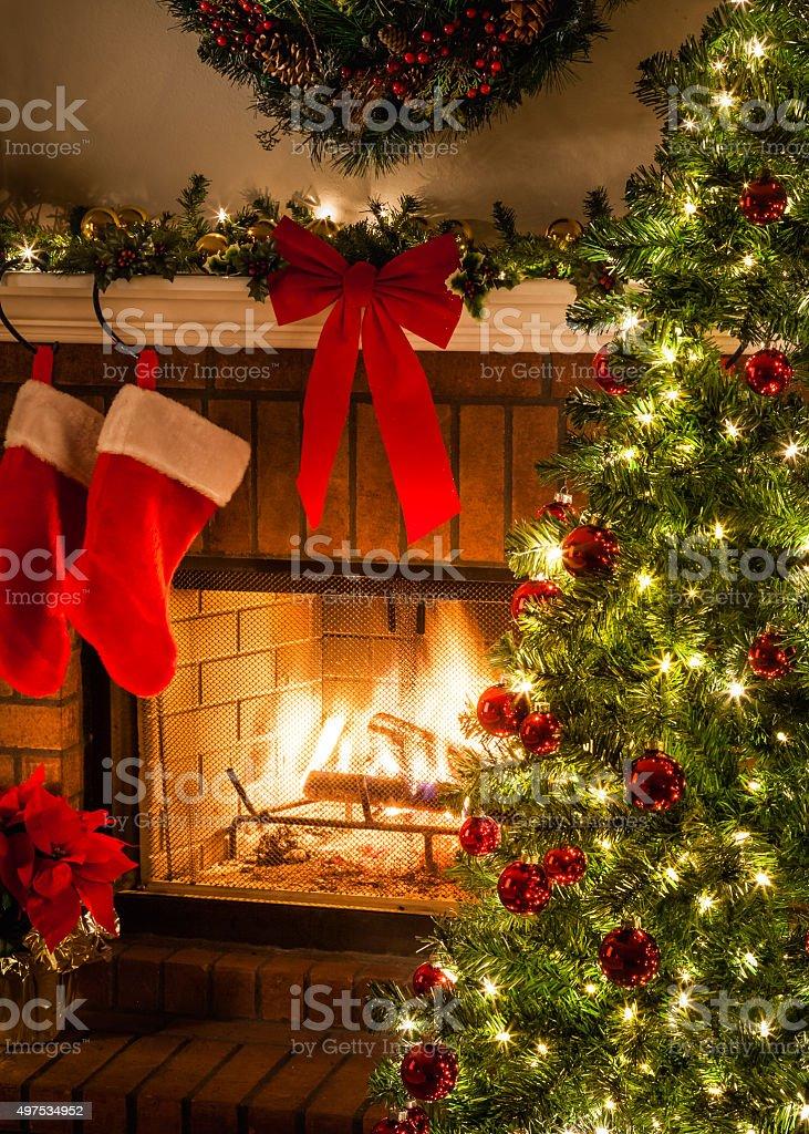 Christmas tree, blaziing fire, stockings, fireplace, wreath, bow stock photo