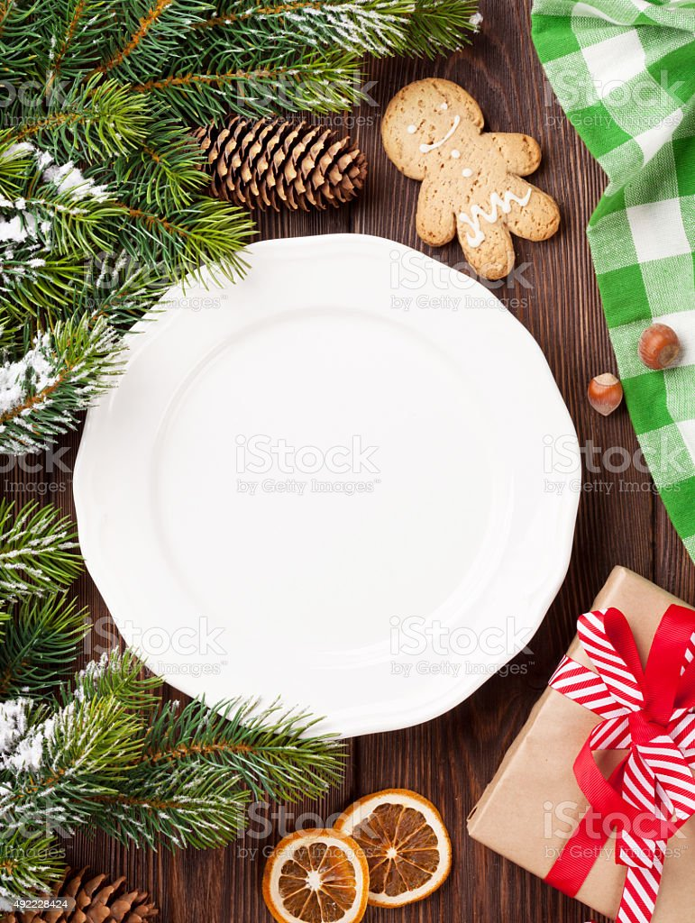 Christmas tree branch, empty plate and coffee stock photo